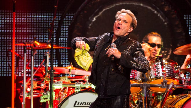 Van Halen at U.S. Airways Center, Saturday night, 6-16-12, during the Phoenix stop of their A Different Kind of Truth Tour.  Wolfgang, Eddie and Alex Van Halen joined frontman David Lee Roth on stage, playing many songs from the early period of the band, as well as several cuts from their new album. David Lee Roth and Alex perform.