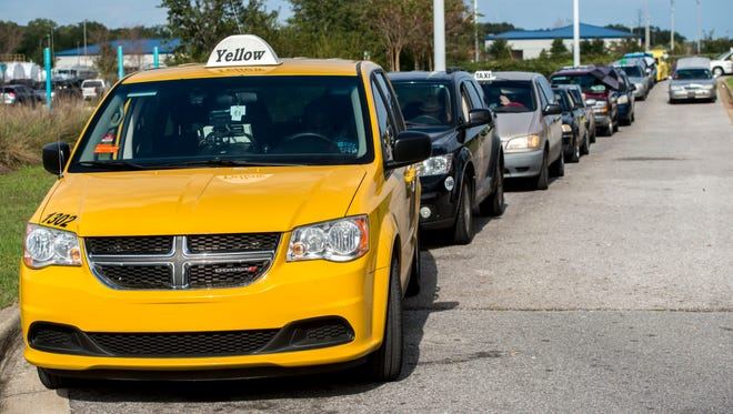FILE PHOTO: Taxis wait at the Pensacola Airport.