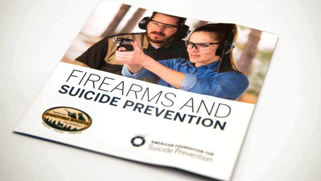 A brochure is on display that is part of an initiative involving the National Shooting Sports Foundation and the American Foundation to Prevent Suicide, Tuesday, Jan. 17, 2017, in Las Vegas. The brochures are supplied to gun dealers and gun ranges to help gun owners understand the warning signs of those at risk of suicide and to find ways to prevent suicide. It's a difficult topic to discuss and an even tougher one to fix, fraught with politics and societal stigmas: people who kill themselves with a gun. But now two unlikely allies, the gun industry and a leading suicide prevention group, are coming together to tackle it.