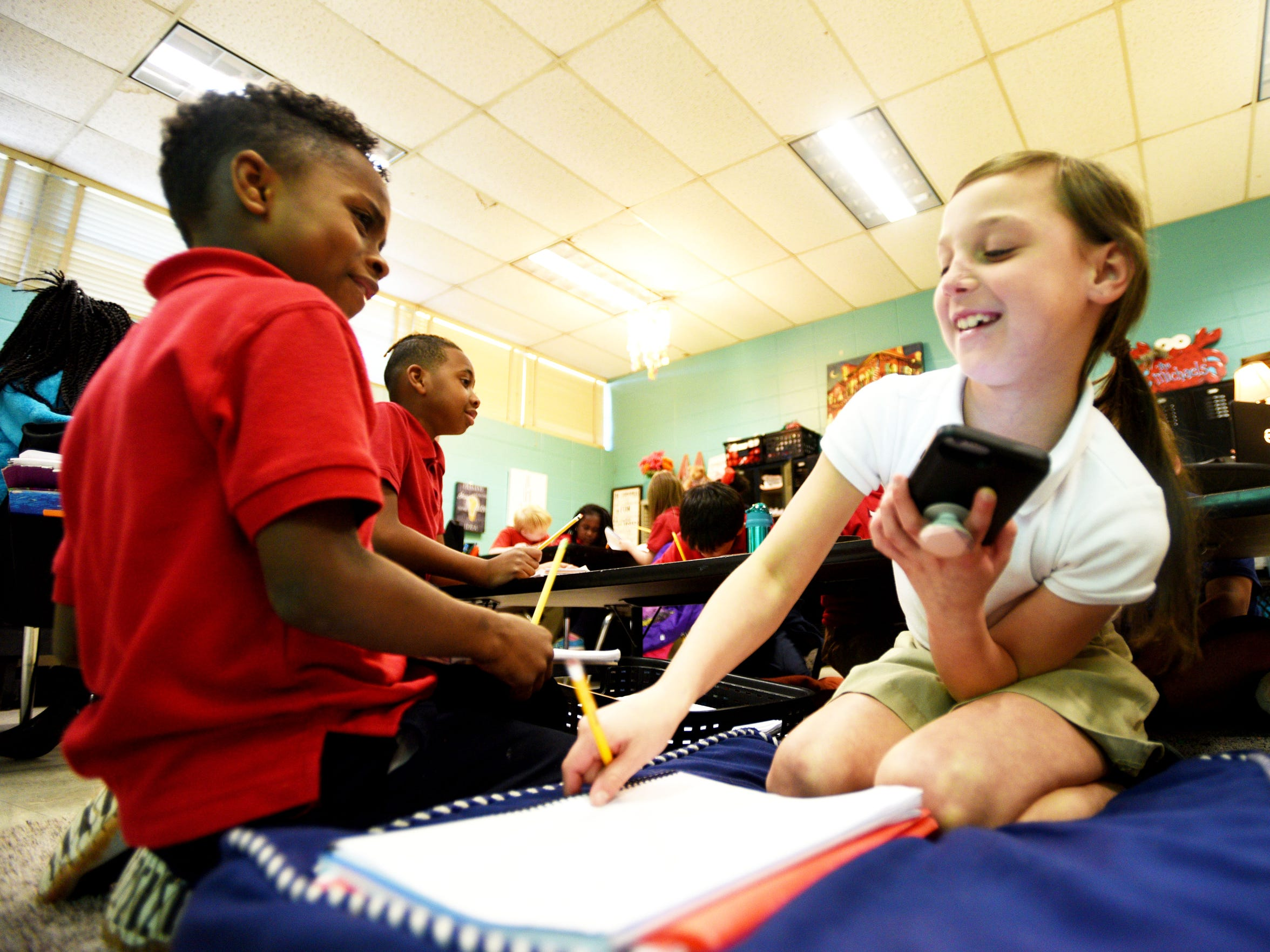 University Elementary students Sir Kamryn Stevens and Amberley Kennedy work together in class Tuesday, December 4, 2018.