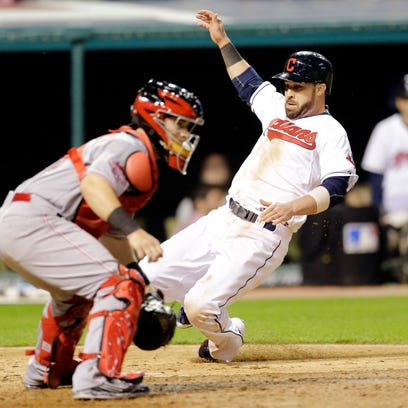 Cleveland Indians' Jason Kipnis, right, scores on an