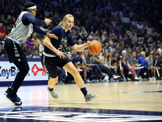 Xavier Musketeers forward Annina €ijŠnen (25) drives