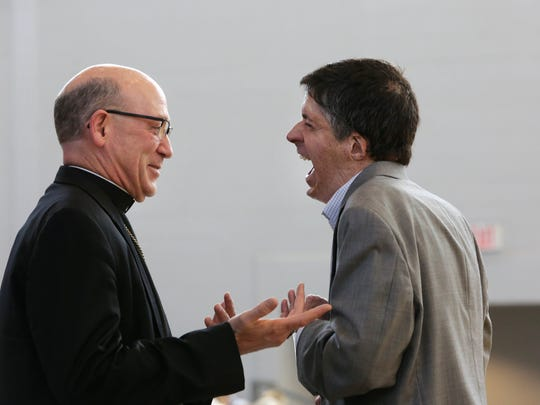 John O'Leary, right, shares a laugh with friend Bishop Edward Rice.