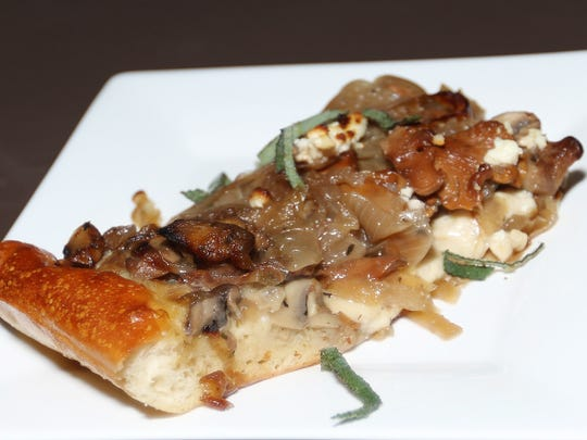 Oregon Rustic Tart of Mushrooms, Caramelized Hermiston Onions, Sage and Goat Cheese paired with 2014 Ingram Lane Riesling was served during a wine pairing event Saturday, Nov. 14, 2015, at Brooks Winery in Amity.