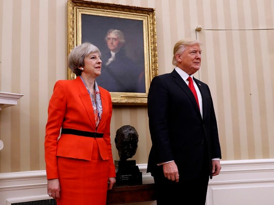 President Donald Trump stands with British Prime Minister