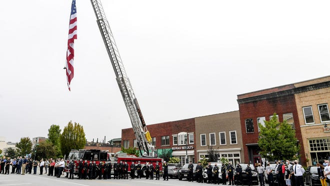Hendersonville fire and police personnel attend a remembrance ceremony on the anniversary of the 9/11 attacks Thursday in Hendersonville.