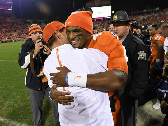 Clemson quarterback Deshaun Watson (4) hugs head coach Dabo Swinney during the closing seconds of the Tigers 56-7 win over South Carolina on Saturday, November 26, 2016 at Clemson's Memorial Stadium.
