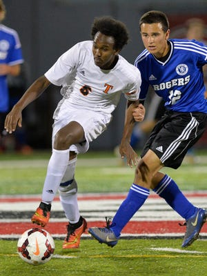 St. Cloud Tech's Mohamud Aden (6) gets ahead of a Rogers defender in the first half Tuesday night, Oct. 20 at Husky Stadium.