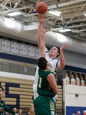 Hartland's Jason Gigliotti nets 2 of his game high 15 points Tuesday night as the Eagles defeated the visiting Howell Highlanders 50-44 in KLAA action.