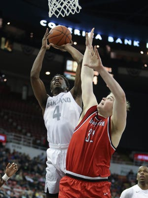 Oakland forward Jalen Hayes scores against Youngstown State center Jorden Kaufman during the first half of Oakland's loss in the Horizon League tournament Saturday at Joe Louis Arena.