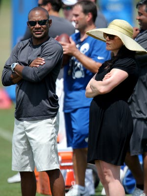 Carlie Irsay-Gordon and Jimmy Raye, vice president of football operations, talk as the Indianapolis Colts practice at training camp, on Sunday, August 10, 2014, in Anderson.