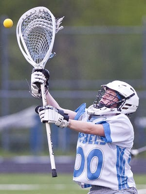 South Burlington goalie Claire Phillips stops a free-position shot against Middlebury during Tuesday's high school girls lacrosse game in South Burlington.
