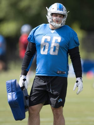 Lions lineman Joe Dahl goes through blocking drills during organized team activities Tuesday, June 6, 2017 at the practice facility in Allen Park.