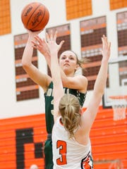 Howell's Amanda Corsten shoots while guarded by Northville's Kendall Dillon on Tuesday, Feb. 6, 2018.