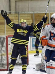 Brenden Tulpa celebrates one of his two second-period goals for Hartland in a 9-1 victory over Flint Powers Catholic on Wednesday, Feb. 7, 2018.