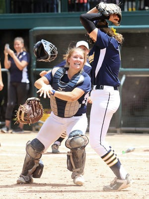 Catcher Brooke Cowan and pitcher Rachel Everett celebrate after Hartland beat Howell, 6-4, in the state Division 1 softball semifinals on Thursday, June 14, 2018.