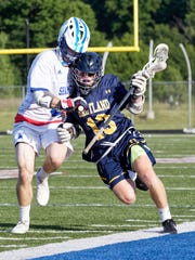 Hartland's Jake Gallaher carries the ball in a 13-12