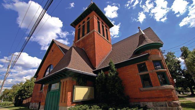 M3 Group will invest $625,000 to turn this church on the corner of Saginaw Street and Seymour Avenue in Lansing into its new office.