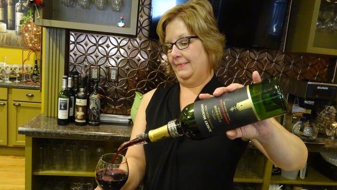 Natalie Norman, owner of Norman's Niche, pours a bourbon barrel-aged Cabernet Sauvignon.