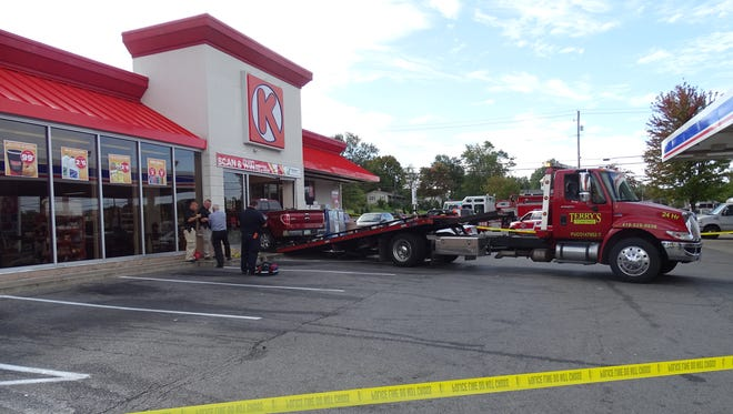 A tow truck pulls a pickup truck out of Circle K Wednesday after the pickup crashed into the convenience store.