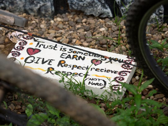 A sign sits among 12 bikes in front of a home in rural Lawrence County in southeast Ohio.