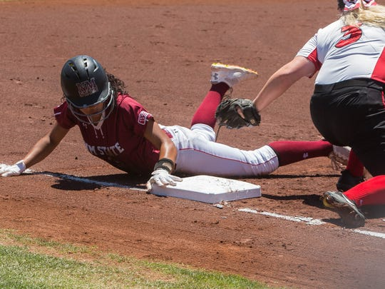 Aggie's Victoria Castro slides into third base as Seattle U's Jessica Flanagan misses the tag during Friday's WAC Tournament game at the NMSU Softball Complex.