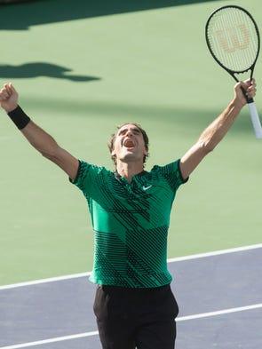 Roger Federer of Switzerland celebrates his championship