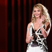"""Miranda Lambert accepts the award for song of the year for """"Automatic"""" at the 50th annual Academy of Country Music Awards at AT&T Stadium on Sunday, April 19, 2015, in Arlington, Texas. (Photo by Chris Pizzello/Invision/AP)"""