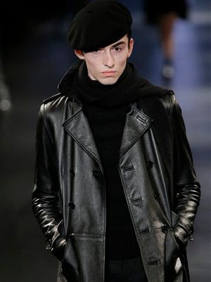 A model wears a creation for Saint Laurent's men's fall-winter 2015/2016 fashion collection presented in Paris, France, Sunday.