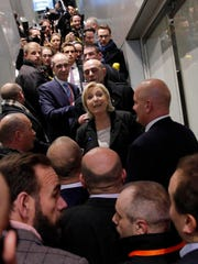 Far-right leader and candidate for next spring presidential elections Marine le Pen, center left, visits the Entrepreneur Fair, Wednesday, Feb. 1, 2017 in Paris, France.