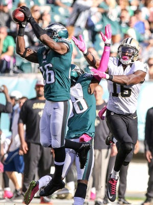 Philadelphia Eagles defensive back Walter Thurmond intercepts a Drew Brees pass before returning it to the 4-yard line during the fourth quarter.