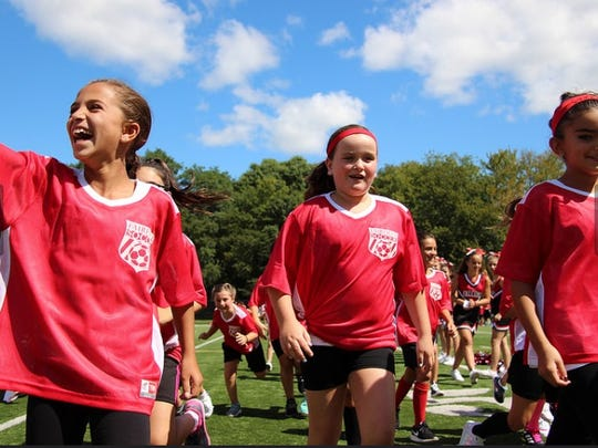 Teammates enjoy the first annual soccer pep rally in