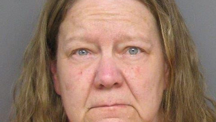 Marlette woman charged in husband's slaying
