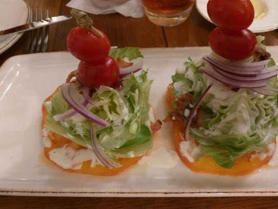 Wind & Waves Grill's iceberg salad is served as two