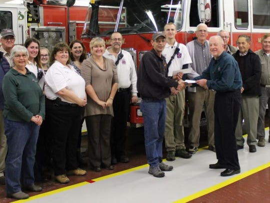 Directors of the the Lemasters Community Association recently presented donations to MMPW fire and ambulance companies, TWEP and Spring Grove Cemetery.