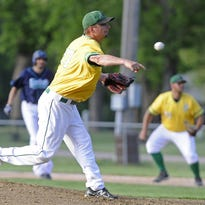 Renner Monarchs' Dallas Schneiderman pitches again the Dell Rapids Mudcats during a game Tuesday night in Dell Rapids. The Monarchs won 11-0.