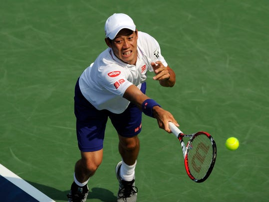 Kei Nishikori, of Japan, lunges for the ball against Sam Querrey during a match at the Citi Open tennis tournament, Wednesday, July 30, 2014, in Washington. (AP Photo/Nick Wass)