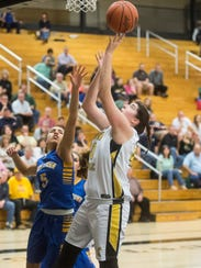 Delone Catholic's Bradi Zumbrum (40) shoots against