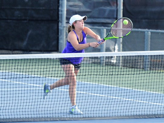 Wylie's Hailey Parker hits a shot at the net during the Region I-4A girls doubles final at Texas Tech's McLeod Tennis Center on Thursday, April 19, 2018. Parker and Madison Andrews won the championship 3-6, 6-4, 7-5.