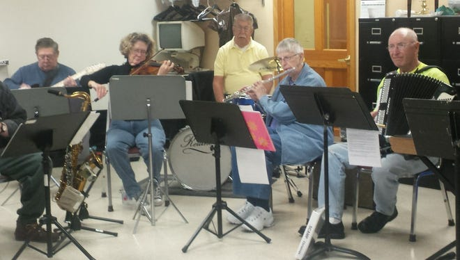 Some of the SCAMP Band members during a Wednesday morning practice session at the Fond du Lac Senior Center. Dick Auchue, SCAMP drummer and Salvation Army Food Pantry volunteer, is in the yellow shirt.