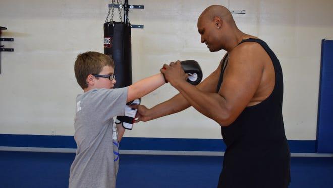 Muhammad Ali's nephew Ibn Ali teaching boxing fitness classes at The J
