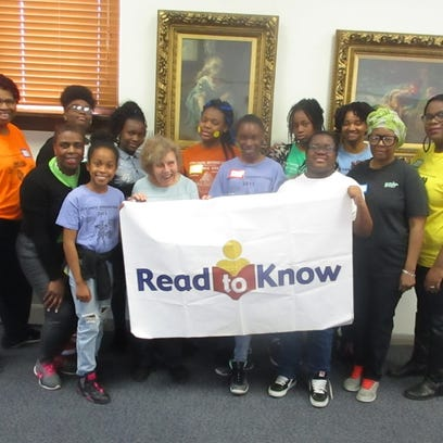 Read to Know founder, Lolly Burgin (front row, second