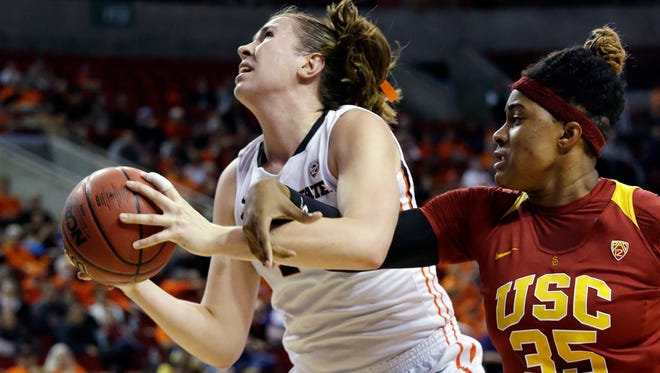 Oregon State's Ruth Hamblin, left, is fouled by Southern California's Kristen Simon during the first half of an NCAA college basketball game in the Pac-12 women's tournament, Friday, March 4, 2016, in Seattle.