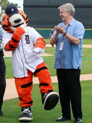 Detroit Tigers mascot Paws and radio broadcaster Dan Dickerson hang out  March 3, 2015, in Lakeland, Fla.