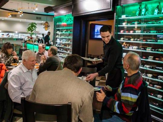Customers dine at Vincenza & Margherita Italian-American Bistro in Wilmington.