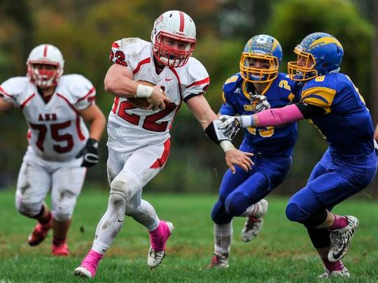Bishop Ahr's Andrew  Brazicki breaks free en route to a 84-yard touchdown run against Spotswood on Oct. 22, 2016