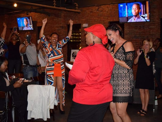 """Tallahassee chef Shacafrica Simmons, known to all as Chef Shac, celebrates at her """"Chopped"""" watch party Wednesday. Chef Shac won the competition and $10,000."""