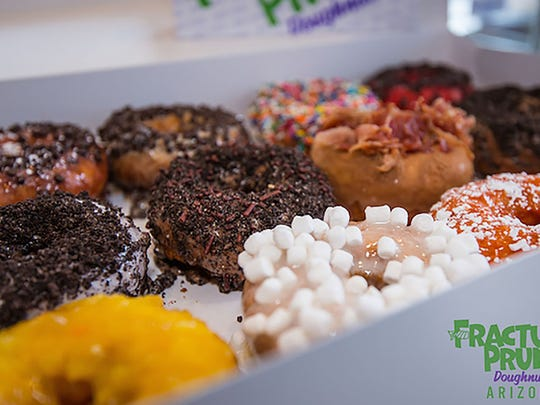 A variety box of doughnuts from Fractured Prune.