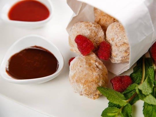 Zeppole with dark chocolate and berry sauces from Angelina's