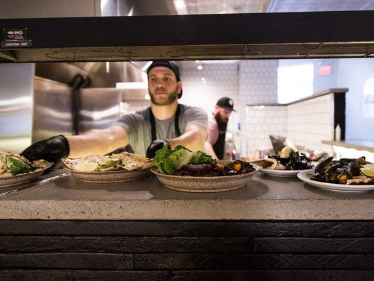 Gather executive chef Nate Vogeli in the kitchen of the new wood-fire-centered restaurant on Gratiot adjacent to Detroit's Eastern Market.